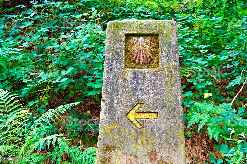 Stone signal that guides the pilgrim to Santiago de Compostela stock photo