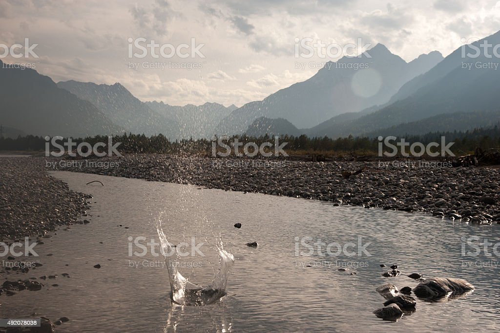 Stone skipping on Lech river at dusk stock photo