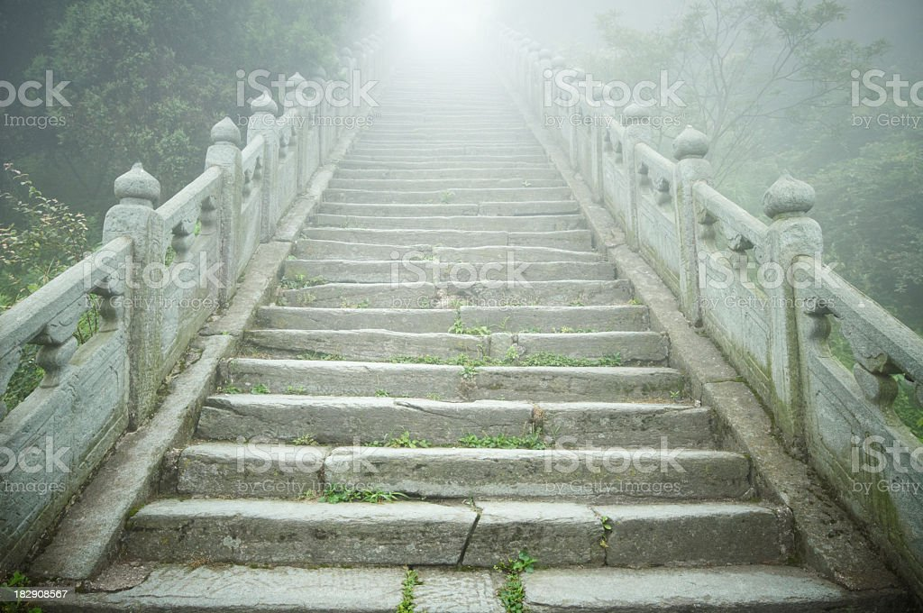 A stone staircase going into light stock photo