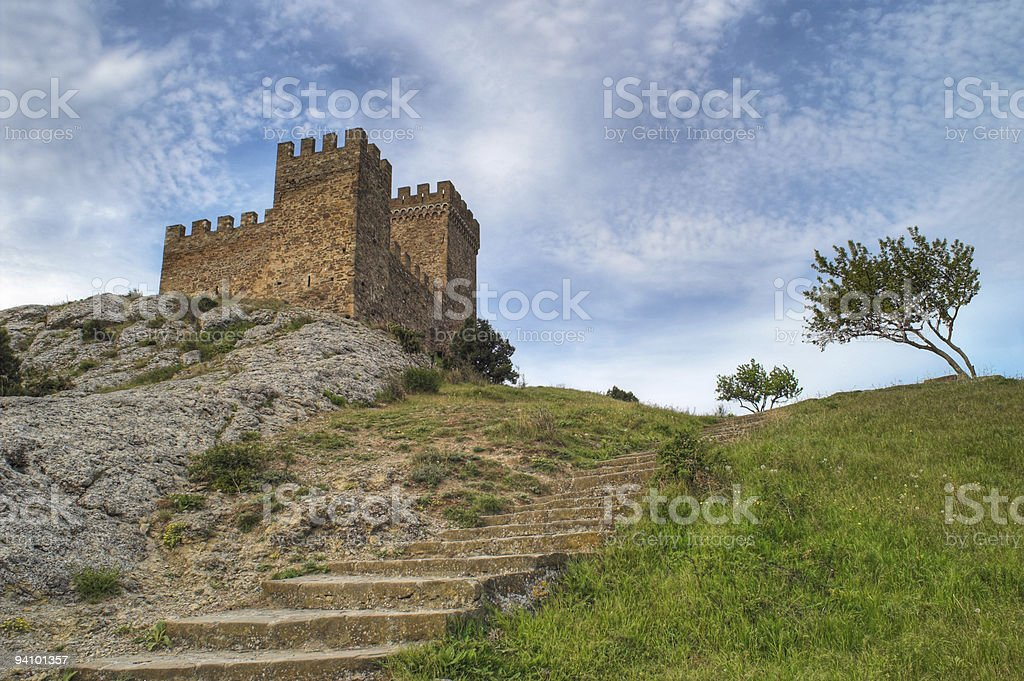 Stone staircase leading to ancient tower on the hill royalty-free stock photo