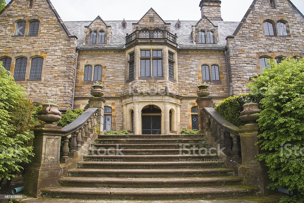 Stone staircase leading to large old house stock photo