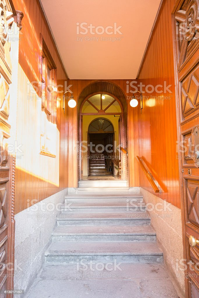 stone stairs and wooden entrance to a building stock photo
