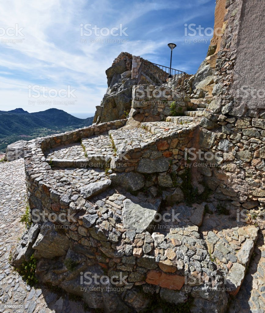 Stone stairs in maws of Saint Antonino Village in Corsica stock photo