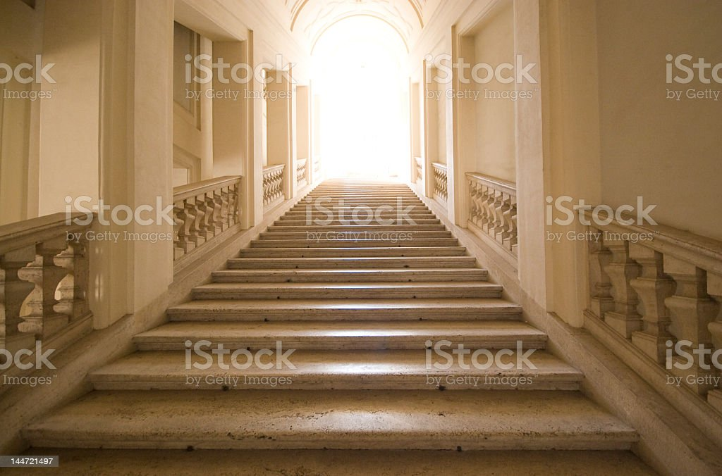 A stone stairway leading to what is presumed to be heaven royalty-free stock photo