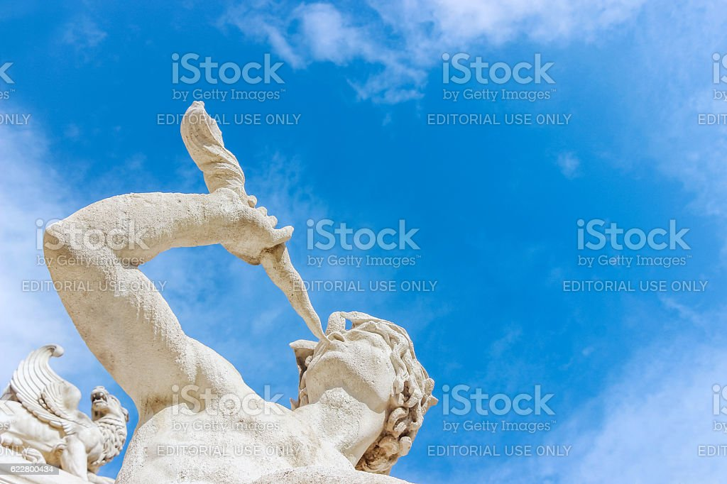 stone statue of man in blue sky stock photo