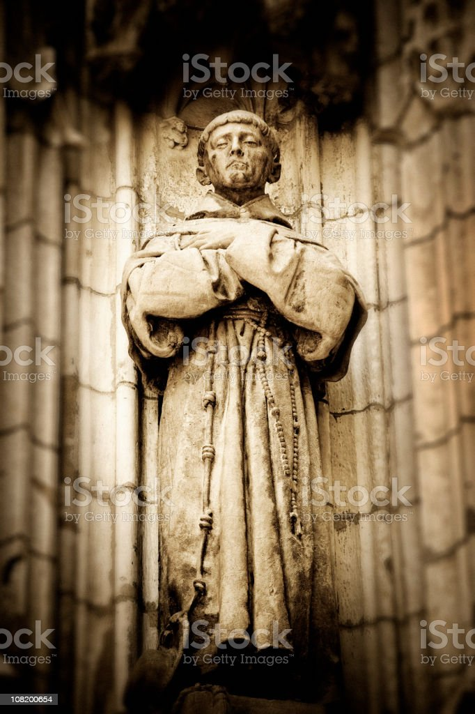 Stone Statue of Monk at Cathedral royalty-free stock photo
