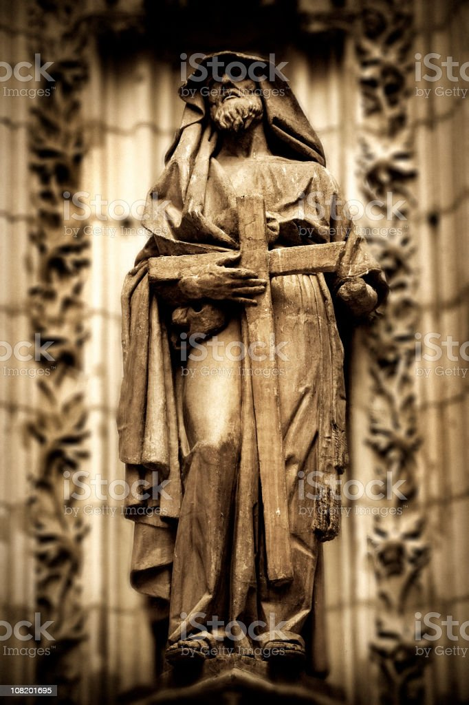 Stone Statue of Monk Holding Cross at Cathedral royalty-free stock photo