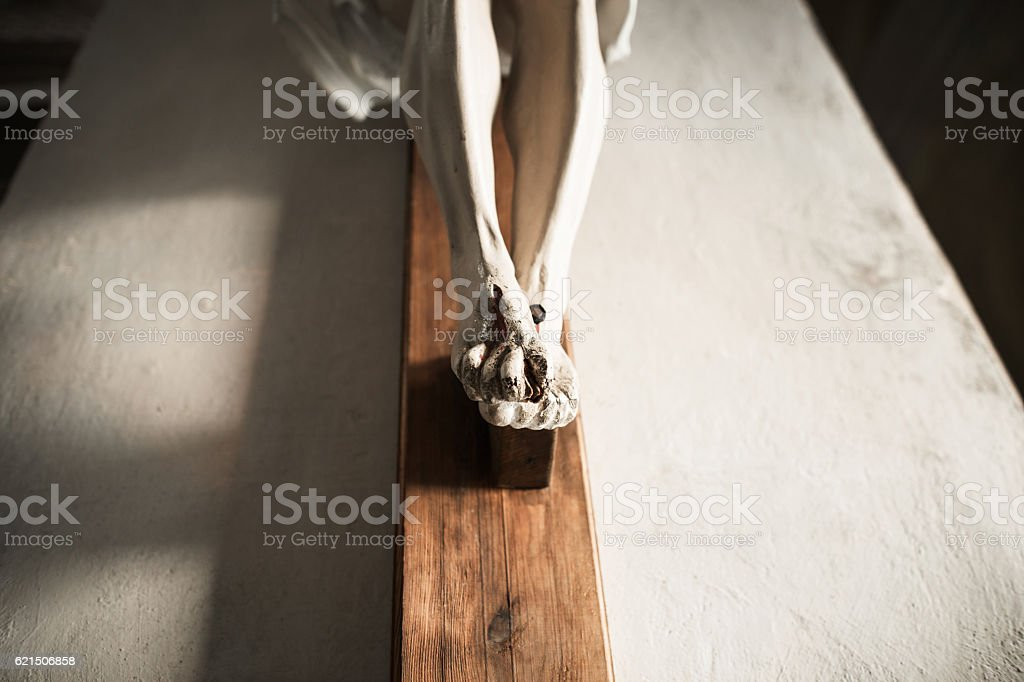 Stone Statue of the Crucifixion of Jesus Christ stock photo