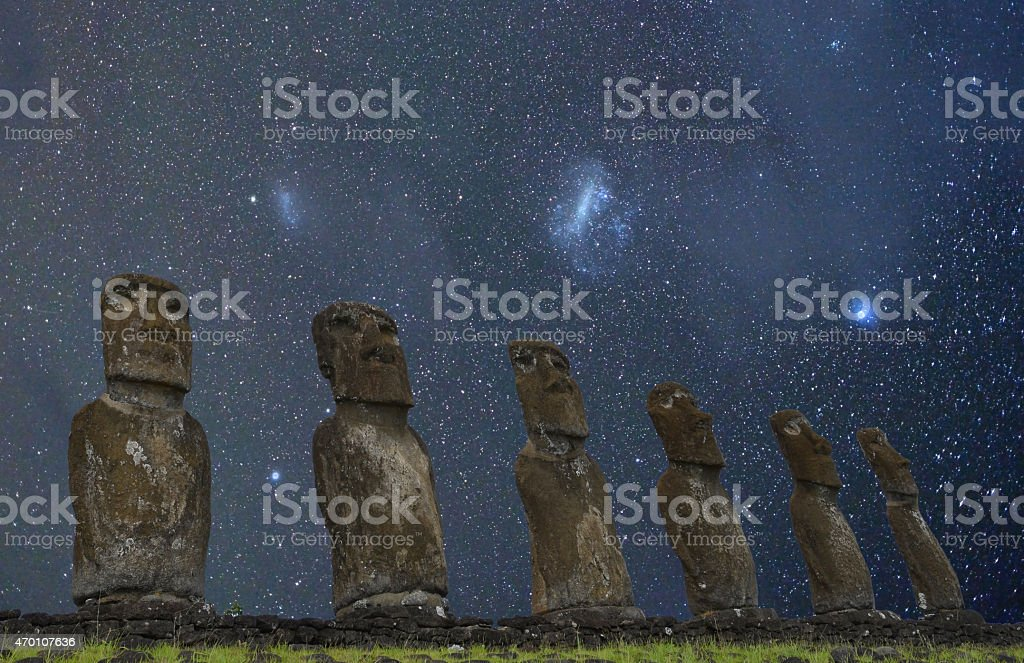 Stone statues at night, Easter Island, Chile stock photo