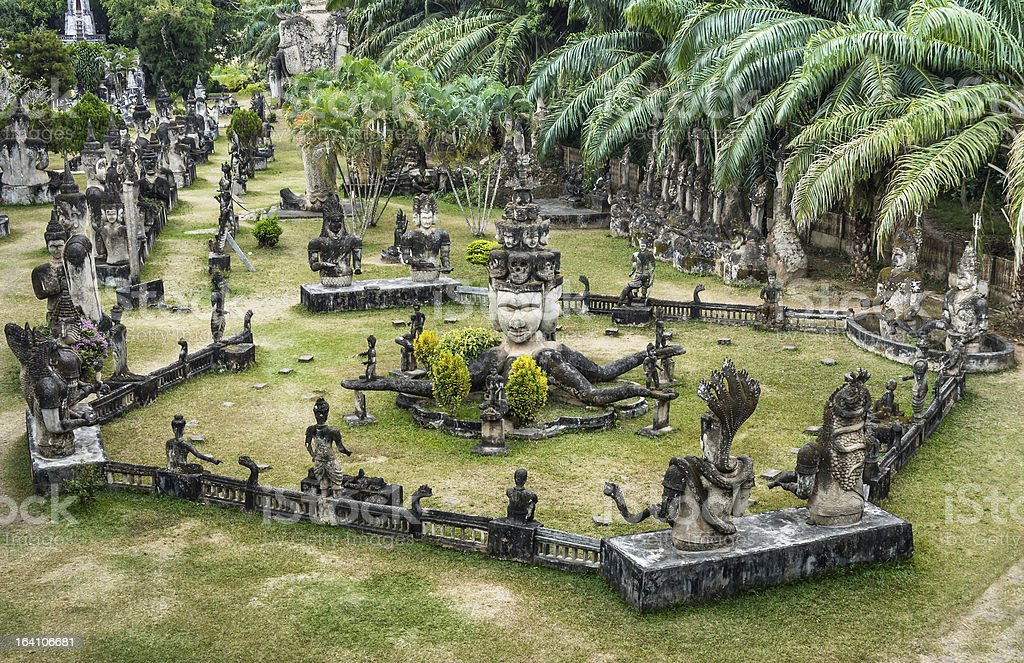 Stone statues of Buddha Park surrounded by greenery stock photo