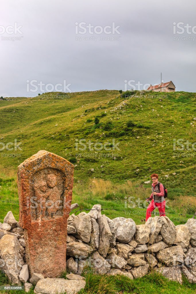Stone Stele with Hiker in Lessinia, Italy stock photo