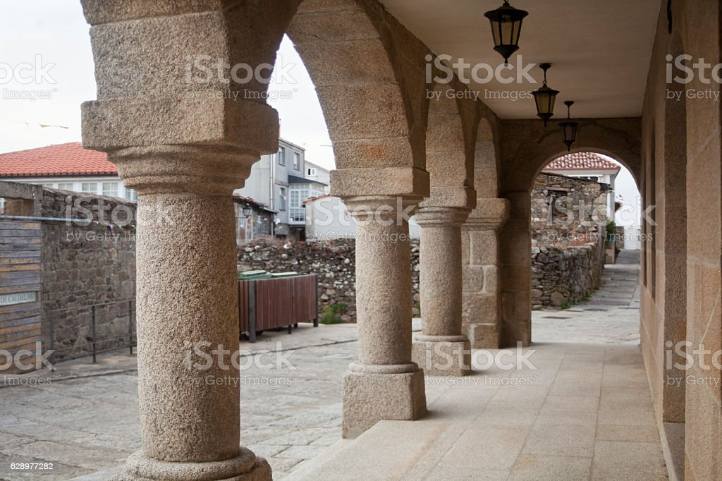 Stone street arcade in Castro Caldelas, Ourense,  Galicia, Spain. stock photo
