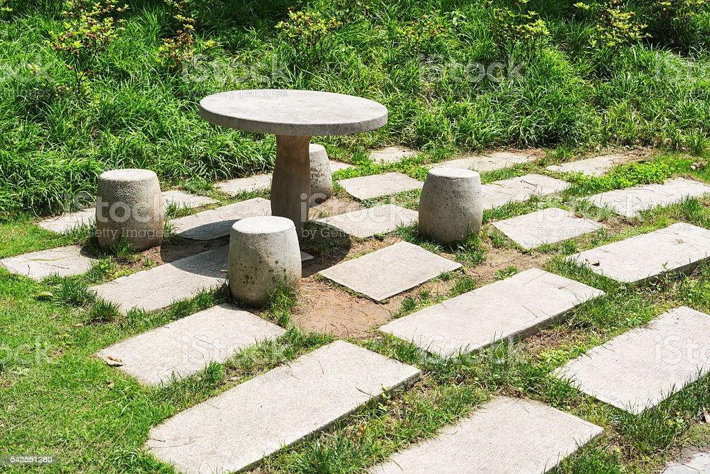 Stone table with stools in the park stock photo