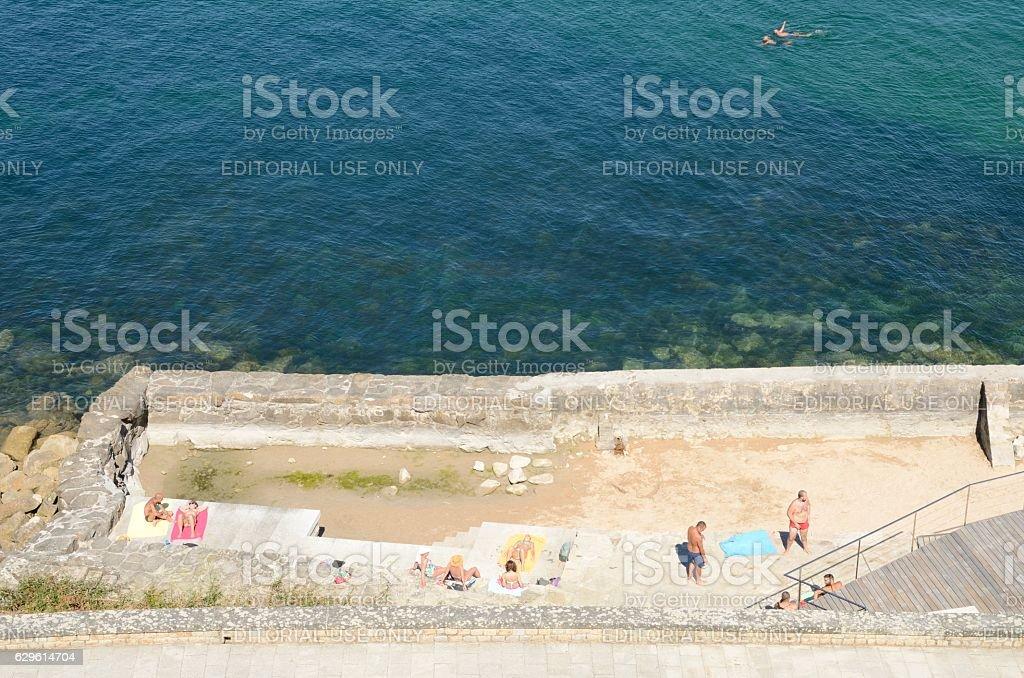 Stone  terrace next  to the sea stock photo