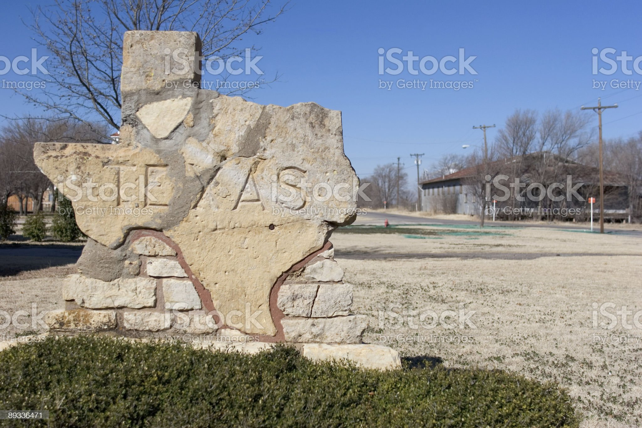 Stone Texas road sign in front of tin building royalty-free stock photo