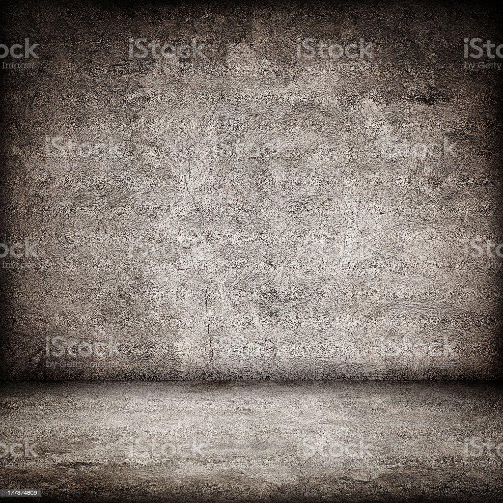 Stone textured grunge interior floor and wall stock photo
