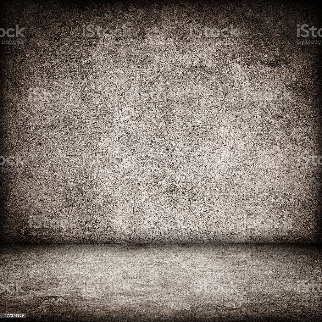 Stone textured grunge interior floor and wall stock photo