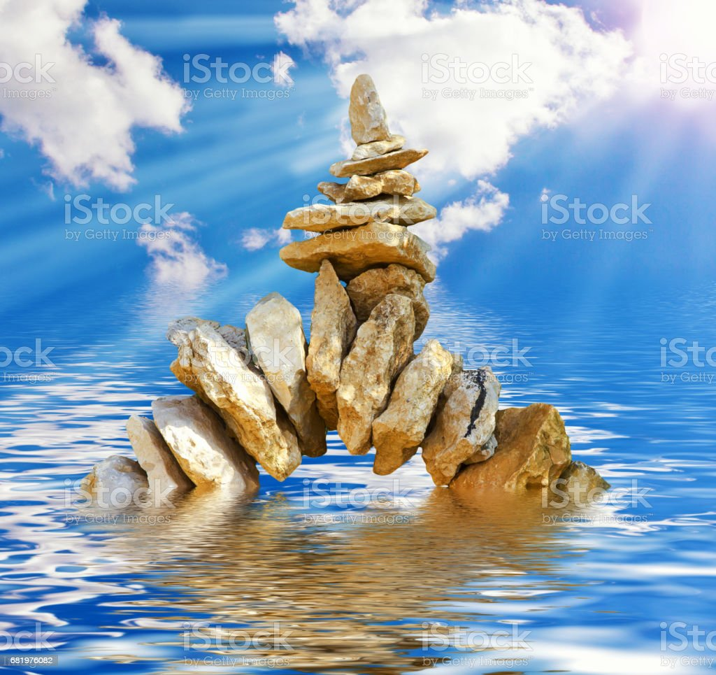Stone tower in water stock photo