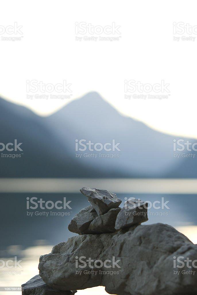 Stone tower near a lake royalty-free stock photo