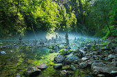 Stone towers in Vintgar gorge and Radovna river in Slovenia