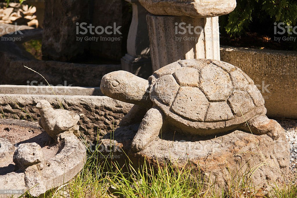 Stone Turtle in the garden stock photo