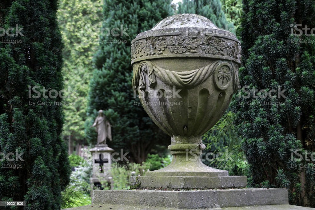 Stone urn on a grave stock photo