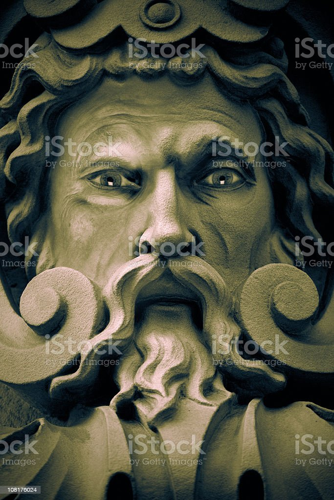 Stone Viking Statue with Long Beard stock photo