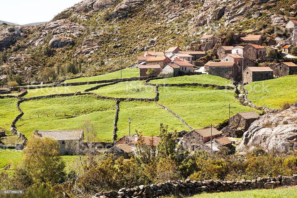 stone village with pastures stock photo