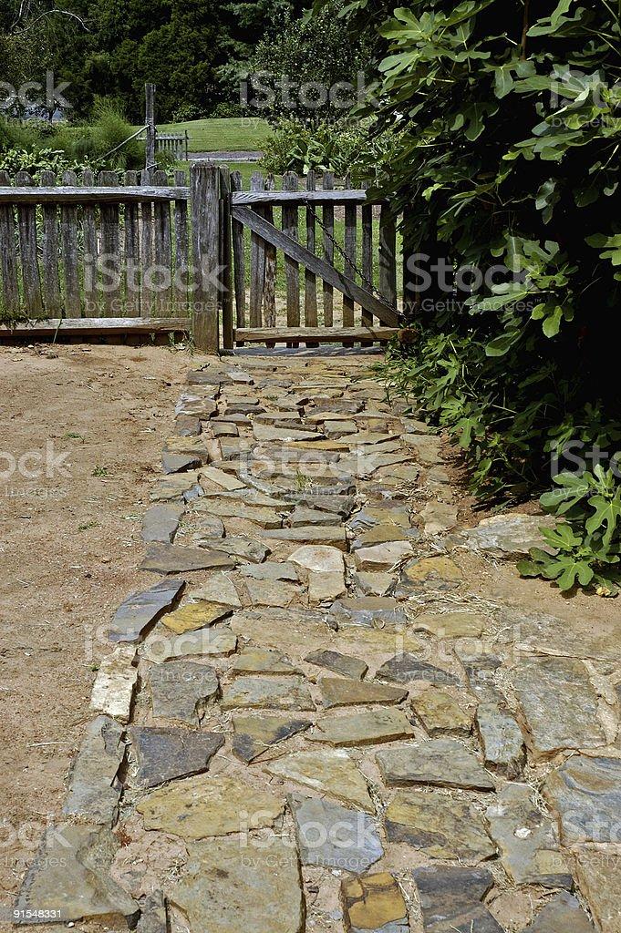 stone walkway to a garden gate royalty-free stock photo