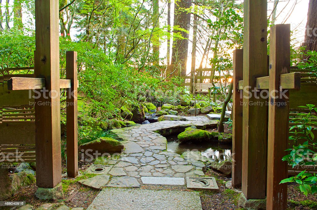 Stone Walkway With Fence And Sun Glow Portland Japanese Garden Royalty Free  Stock Photo