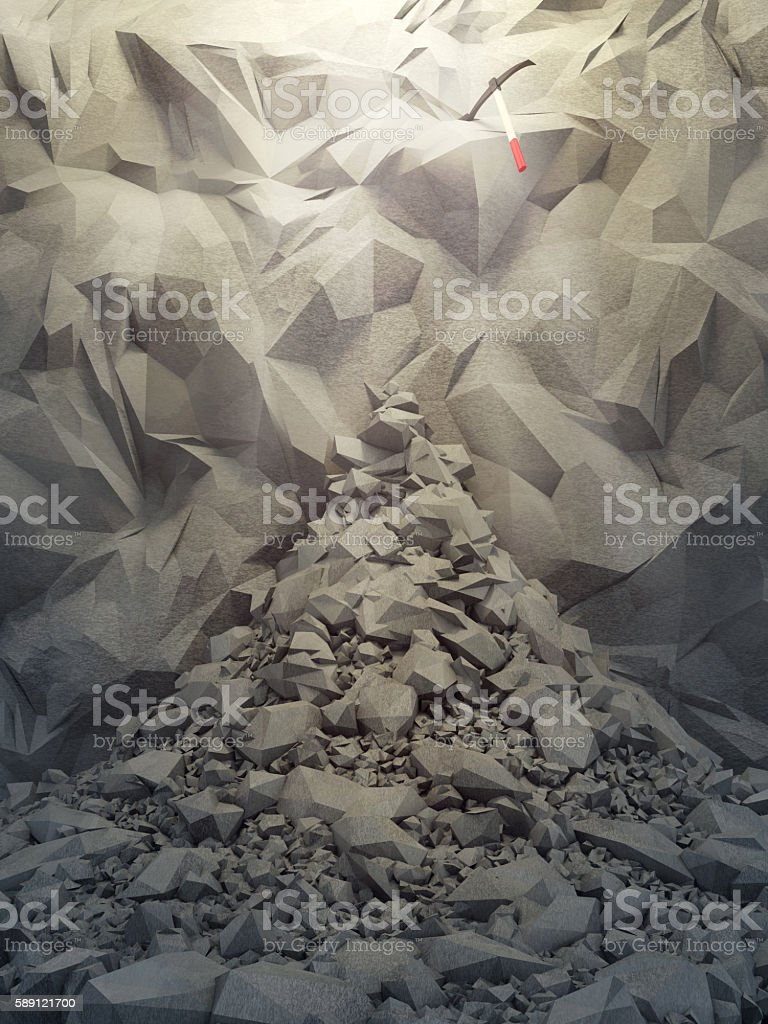 stone wall and pickax stock photo