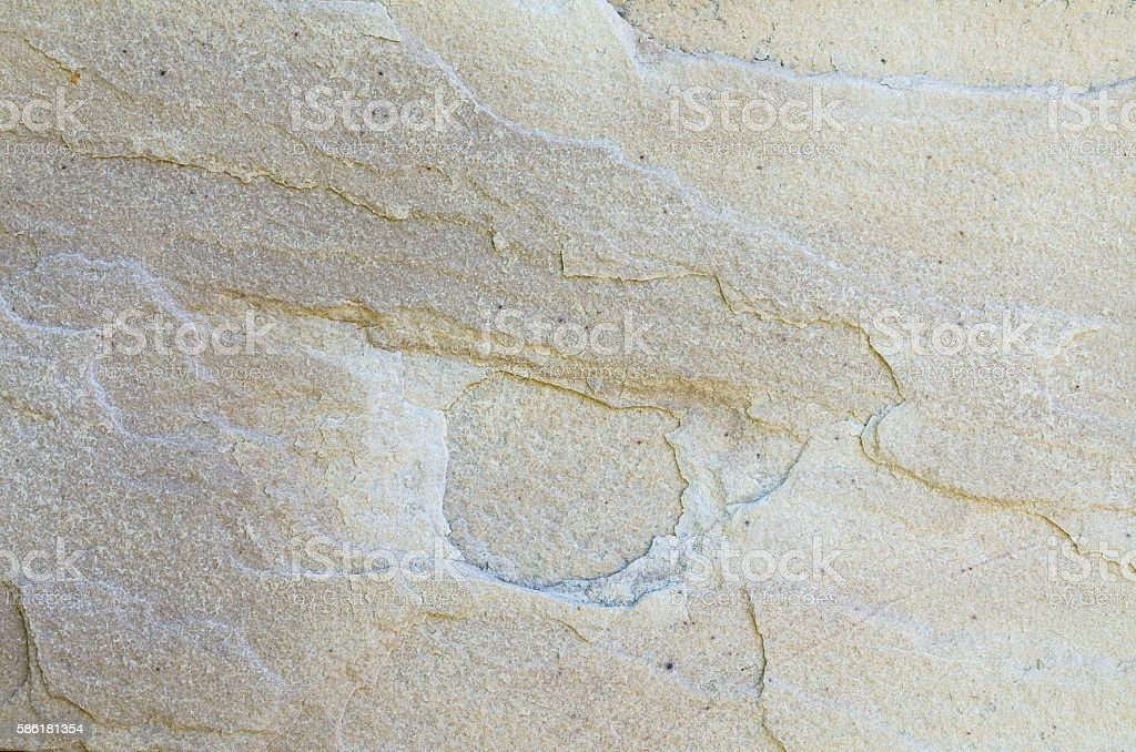 stone wall cracks texture and background stock photo