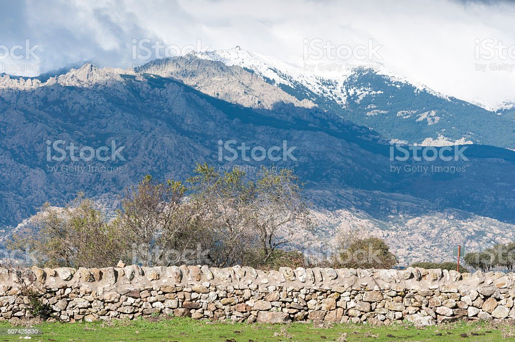 Stone wall in the field. stock photo