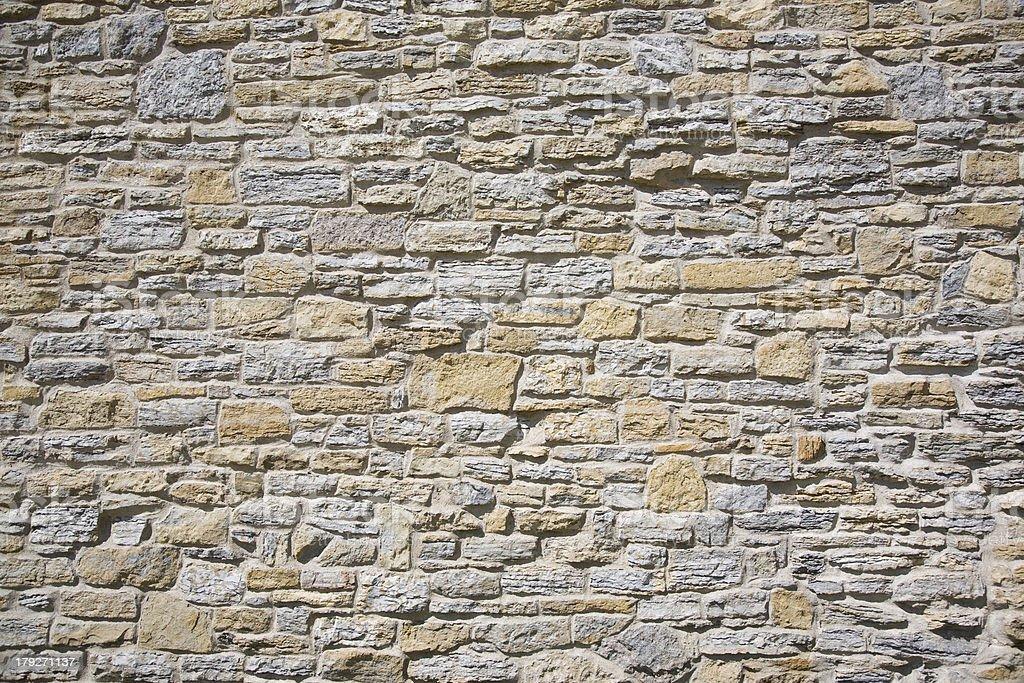 Stone wall made of limestone stock photo