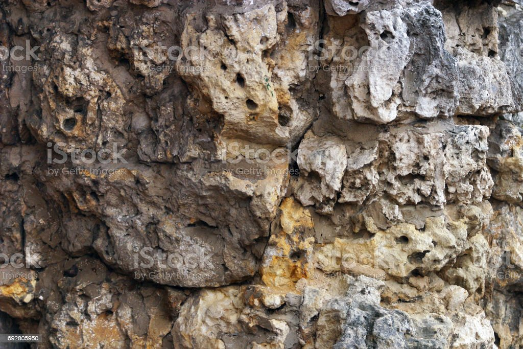 Stone wall made with irregular stone stock photo