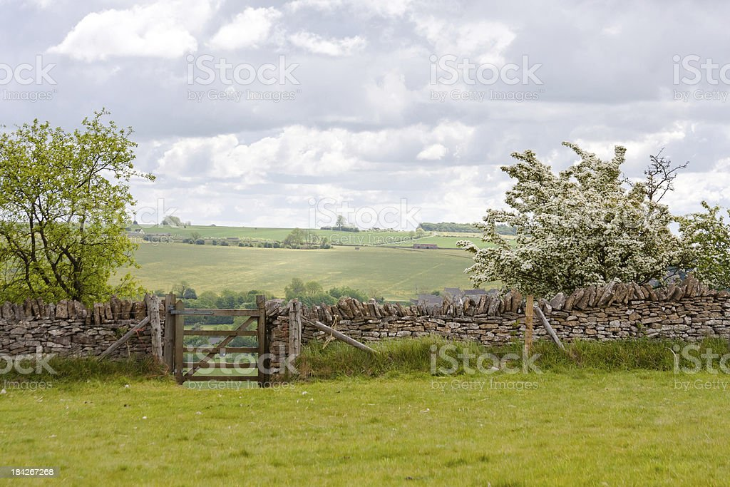 'Stone Wall With A Gate In Cotswald, United Kingdom' stock photo