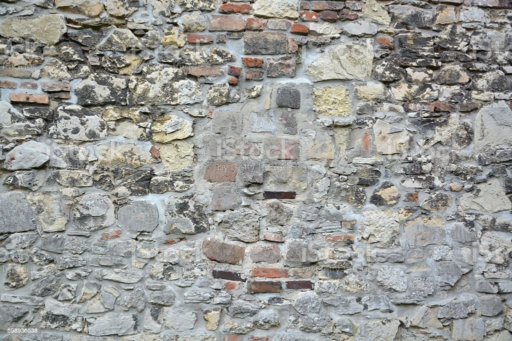 Stone wall with abstract pattern stock photo