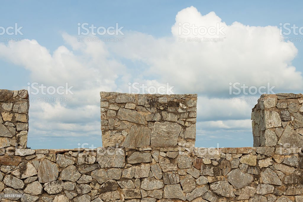 Stone wall with blue sky background royalty-free stock photo
