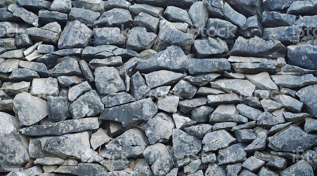 stone wall with dark stones royalty-free stock photo