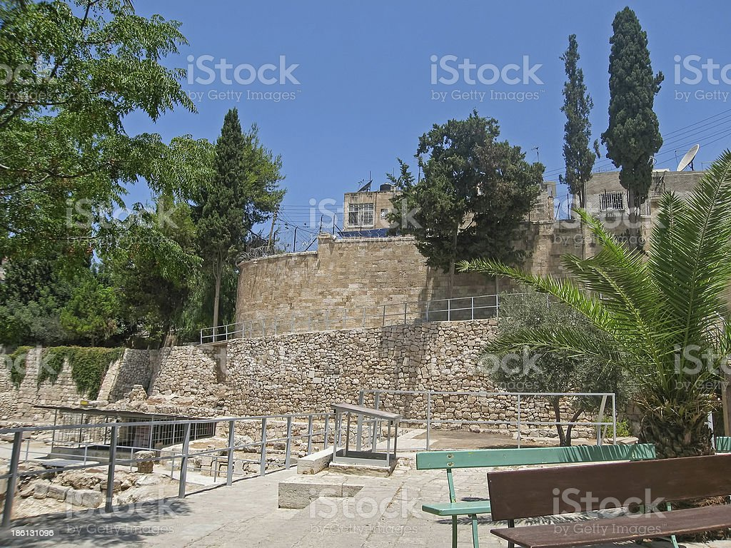 Stone wall with fence in ancient Pool of Bethesda stock photo