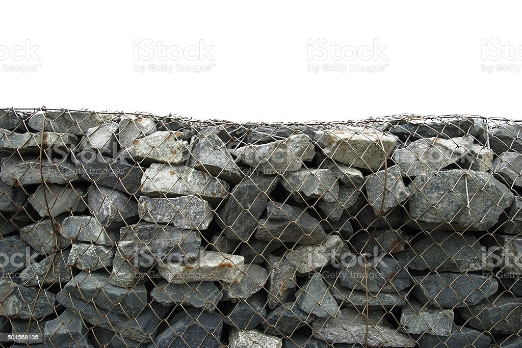 Stone wall with wire mesh against white background royalty-free stock photo