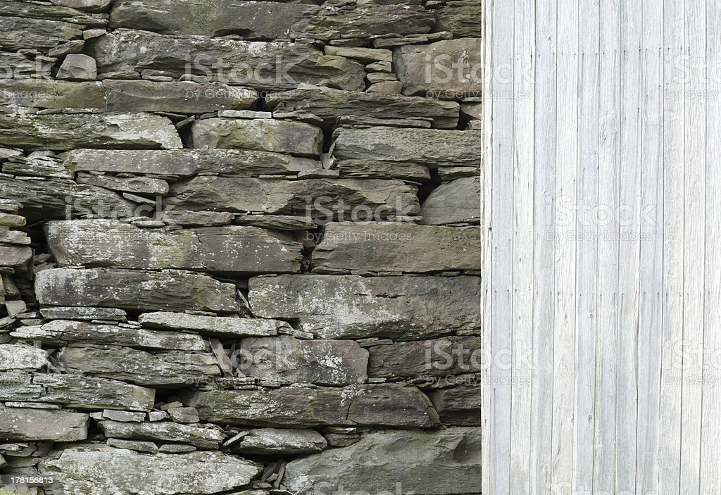 Stone Wall with Wood Siding Background. royalty-free stock photo