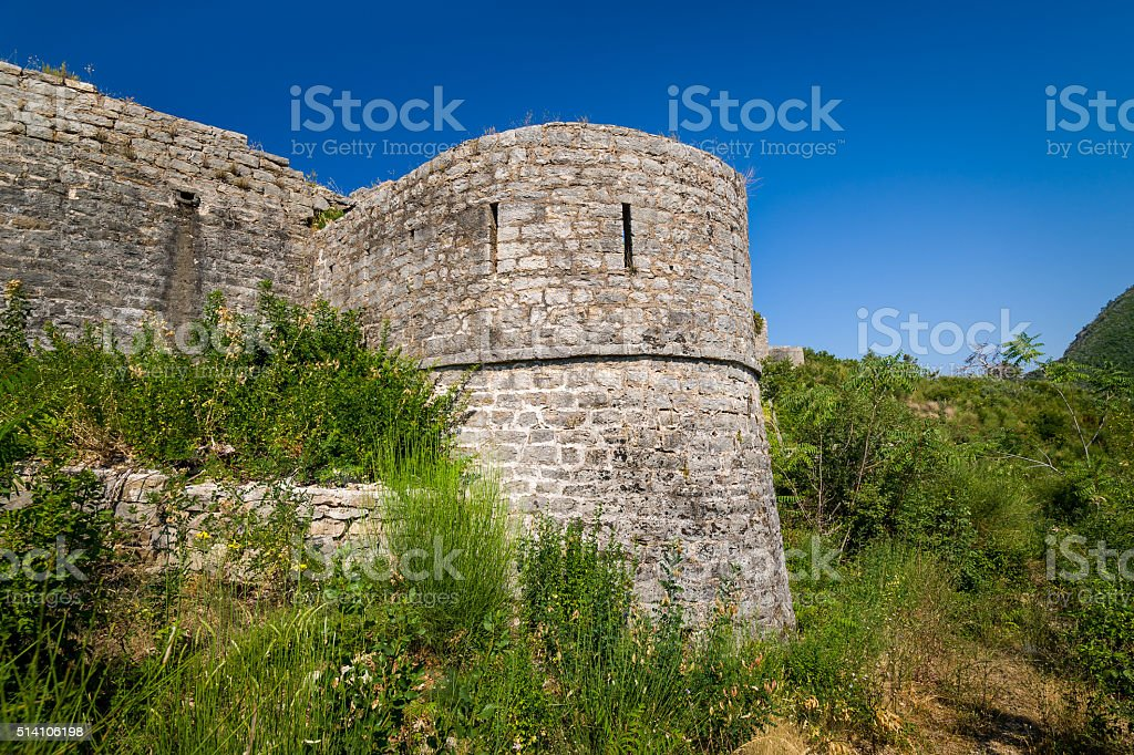 Stone walls and defence tower of Tvrdava Mogren fortress stock photo