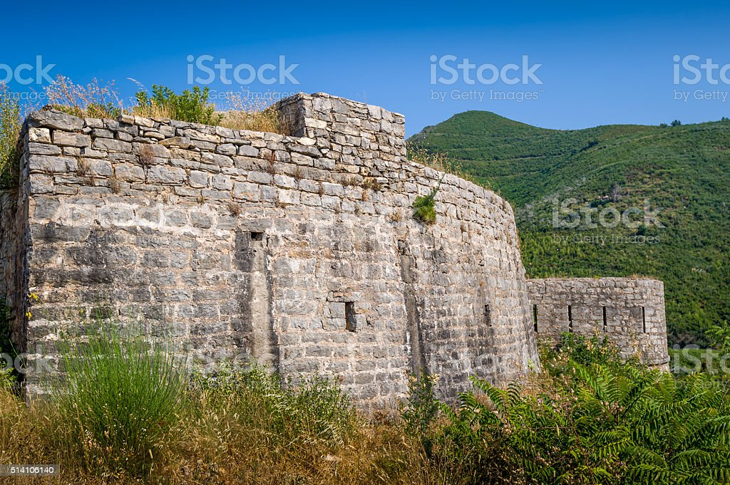 Stone walls of Tvrdava Mogren old fortress in Montenegro stock photo