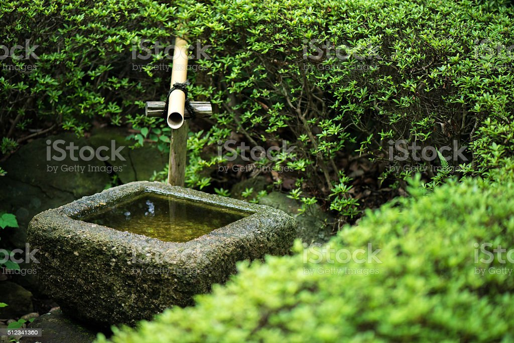 Stone wash basin found in Japanese gardens stock photo