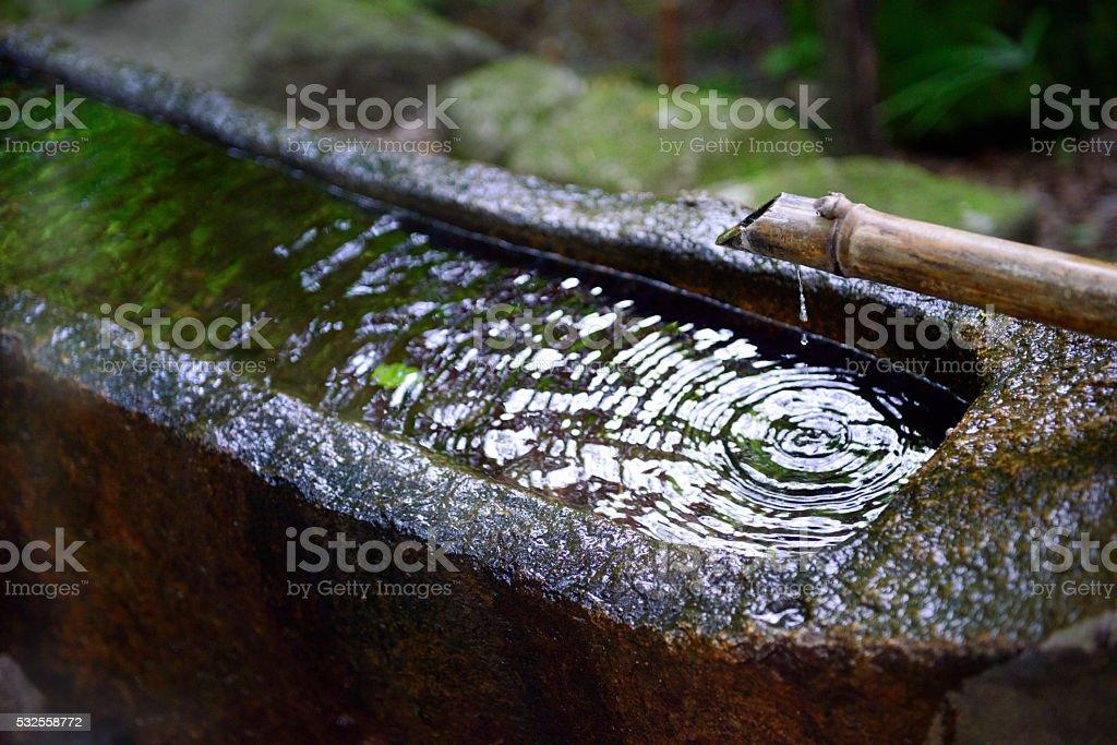 Stone wash basin found in Japanese gardens stock photo