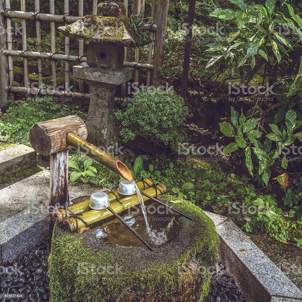 Stone washbasin in the garden stock photo