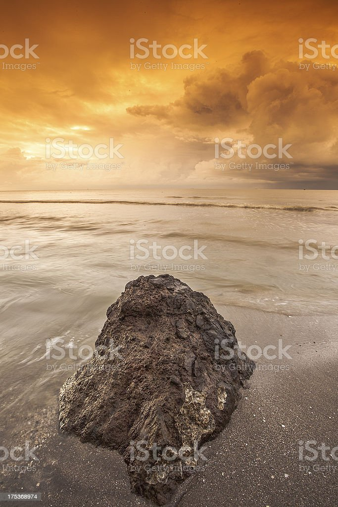 stone with background cloud that is dramatic royalty-free stock photo