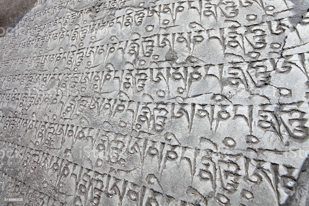 Stone with buddhist mantras stock photo