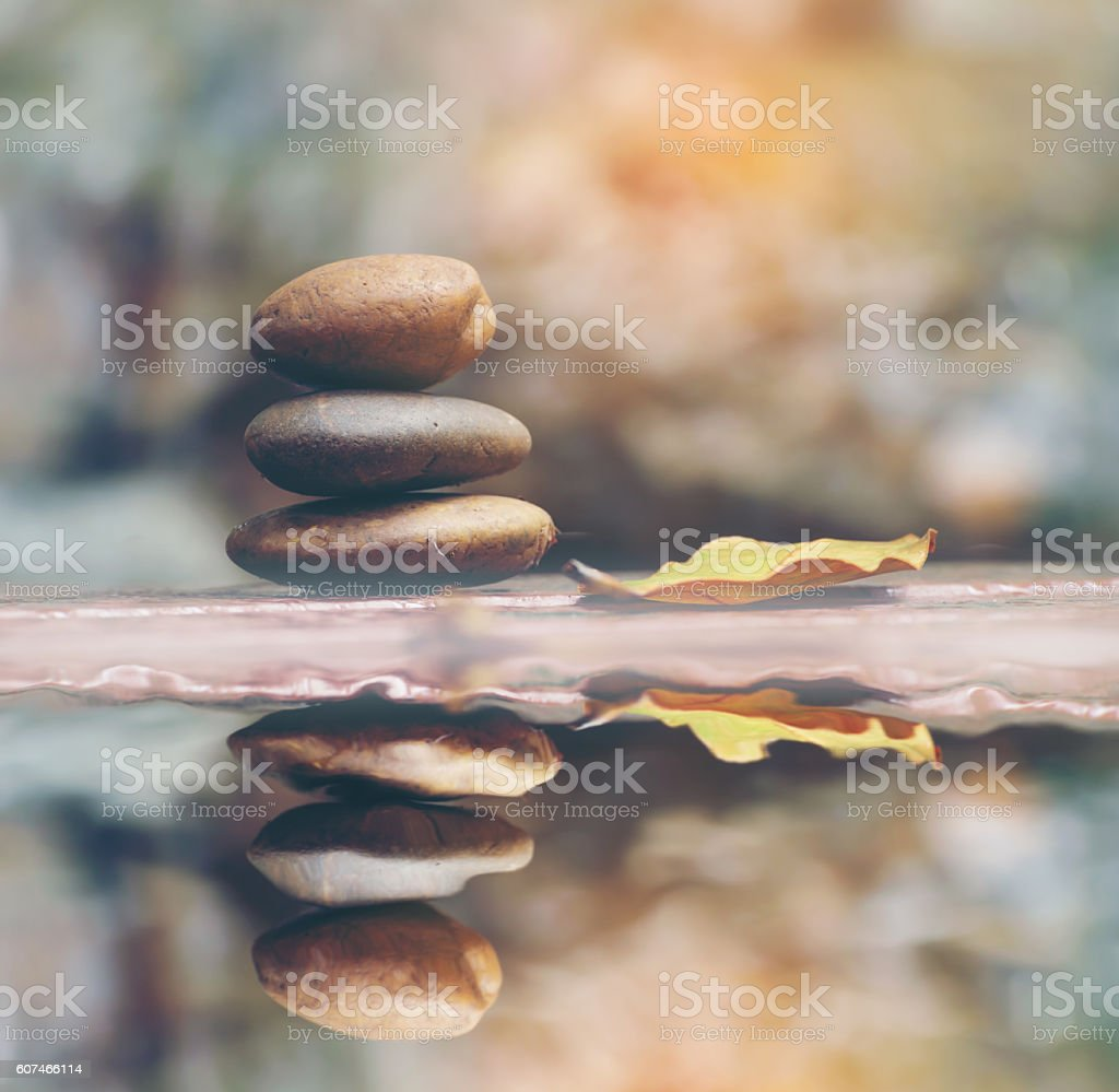 Stone with water reflection stock photo